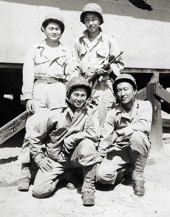 Soldiers preparing for a 25-mile training hike. The 442nd had to complete the hike in 8 hours and the entire regiment completed the rigorous hike in 7 hours and 55 minutes. Top row: Unidentified soldier and Moriso Teraoka. Front row: Robert Ikari and Theodore Akimoto. Camp Shelby, Mississippi.