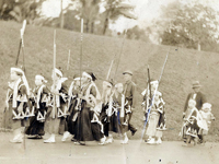 Plantation children dressed as the 47 ronin (Chushingura) marching in the New Years Day parade to the Wainaku Jodo Mission Japanese Language School, about a half-mile from the Wainaku Mill Camp. Hilo, Hawaii. 1930.