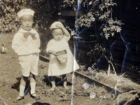 Yutaka Teraoka, at left and Moriso Teraoka, on right, feeding ducks. Hilo, Hawaii. Ca. 1926.