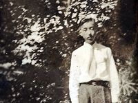 Moriso Teraoka standing in yard, possibly when he was a student at Hilo Intermediate School.