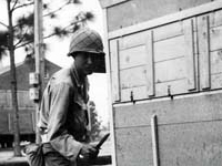 Moriso Teraoka posing in front of living quarters. Camp Shelby, Mississippi. May 1944.