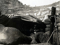 View of 88mm mortar in the Maritime Alps. Champagne Campaign. France. Winter of 1944 to Spring of 1945.