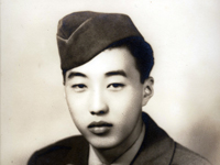 Studio portrait of Moriso Teraoka in uniform taken after returning home from the war. Hilo, Hawaii. January 1946