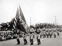 442nd Regimental Combat Team marching in de-activation ceremony at Kapiolani Park. Honolulu, Hawaii. August 1946.